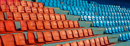 football stands on sport stadium, red and blue, horizontal photo Stock Photo