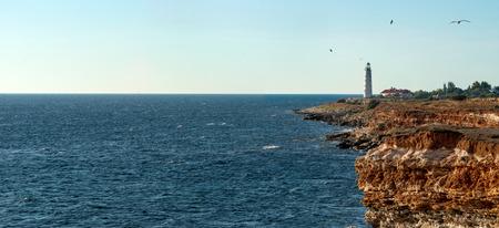 Beauty nature sea landscape with Chersonese beacon( Crimea, Sevastopol), horizontal panorama photo Stock Photo