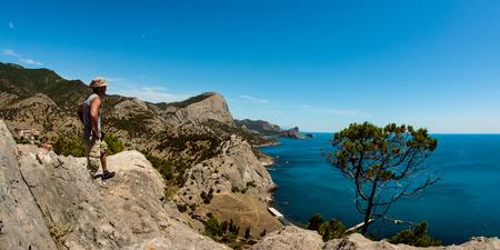 hiker on beauty landscape Crimea ( New World, Novy Svet) background, holiday traveling concept, horizontal photo Stock Photo