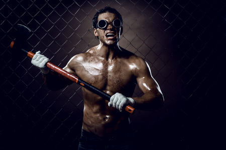 crazy frenzied chopper  butcher man covered with blood, action with big axe  Stock Photo