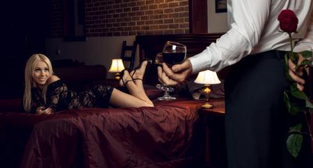 romantic evening date couple in hotel room