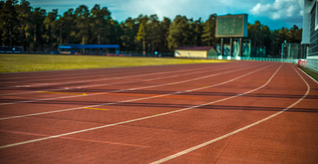 track and field athletics with red soil track, outdoor