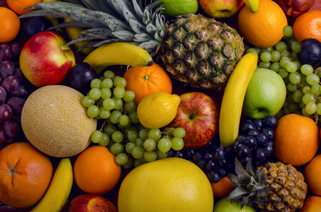 still life of big  heap multi-coloured fruits,  background