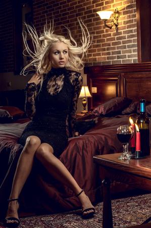 very sexy pretty blonde woman indoor in interior bedroom