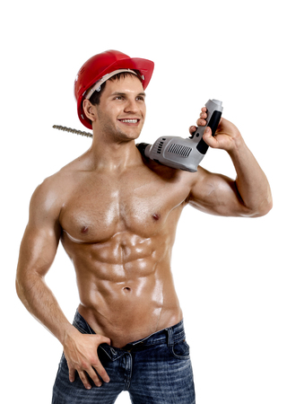 beauty sexy worker driller man, wield with perforator, on white background, isolated