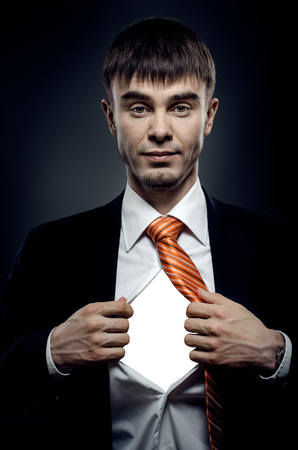 portrait businessman in costume throw open one's shirt