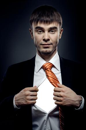portrait businessman in costume throw open ones shirt