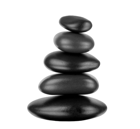 still life of pile black stone for spa treatment, on white background; isolated