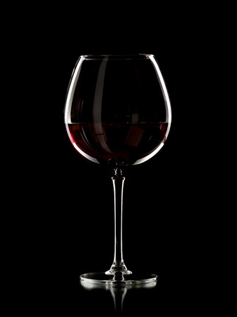 wine glass with red wine, photo on black background