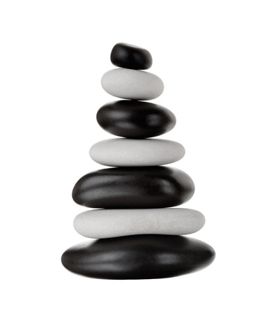 still life of pile white and black stone for spa treatment, on white background; isolated
