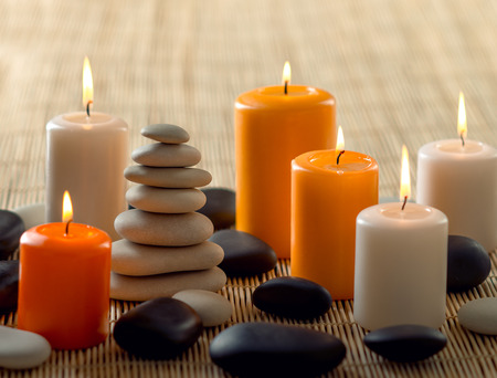 still life group of candle and stone spa treatment, horizontal photo Stock Photo