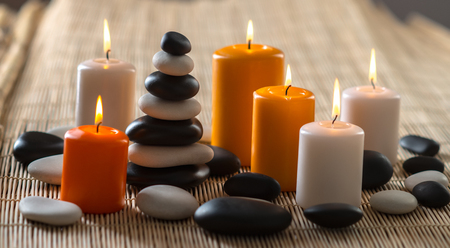 still life group of candle and stone spa treatment, horizontal photo Reklamní fotografie