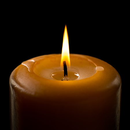 flame of candle, close up, on black background; isolated