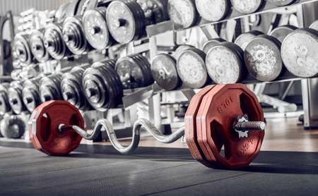 sports equipment in gym , barbell, horizontal photo Reklamní fotografie