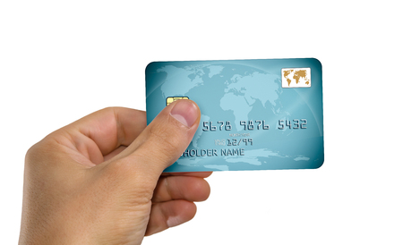 hand holds credit card, closeup photo, white background; isolated Reklamní fotografie