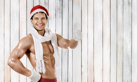 fitness sexy Santa Claus in white muffler, smile