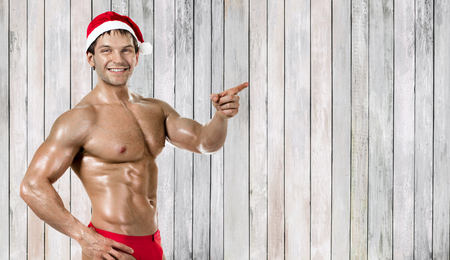 fitness sexy Santa Claus , show index finger and smile Reklamní fotografie