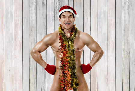 fitness sexy Santa Claus in decoration tinsel, smile
