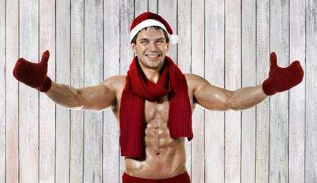 fitness sexy Santa Claus in red muffler, smile Reklamní fotografie
