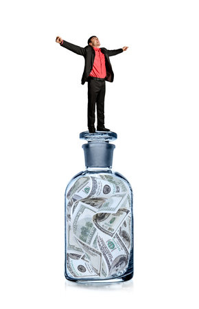 businessman with glass bottle with USA dollars, finance (money, bank) concept, photo on white background, isolated Reklamní fotografie