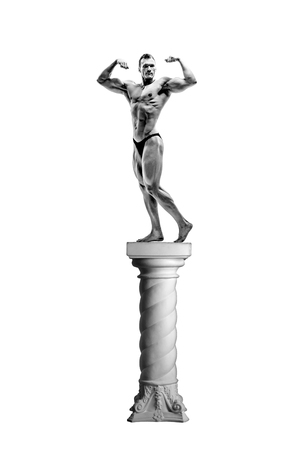 man bodybuilder pose on pedestal, on white background; isolated Stock Photo