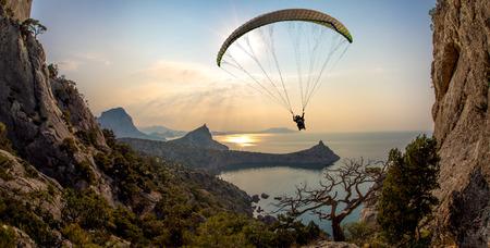 flying on paraplane on beauty landscape background, extreme rest сoncept Reklamní fotografie