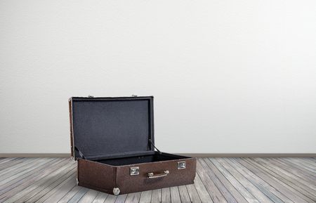 big open vintage empty suitcase in empty room on floor, concept get ready for travel