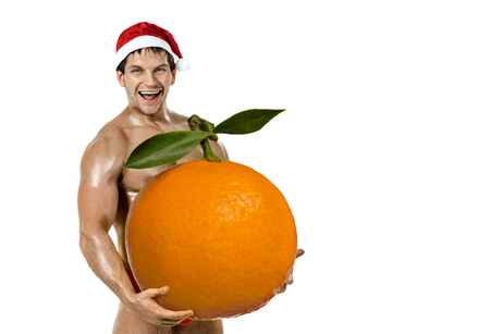 fitness Santa Claus hold great orange tangerine and laughing, on white background, isolated Reklamní fotografie