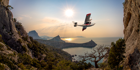 hydroplane flying over beauty sea bay , concept excursion on airplane, horizontal photo