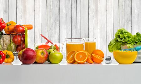 still life cfreshly squeezed juice, fruit and vegetables on table Reklamní fotografie