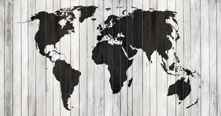 black-and-white contoured map world on background of old wood plank