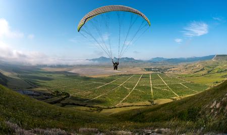 flying on paraplane on beauty landscape background, extreme rest сoncept, horizontal photo Reklamní fotografie - 117852520