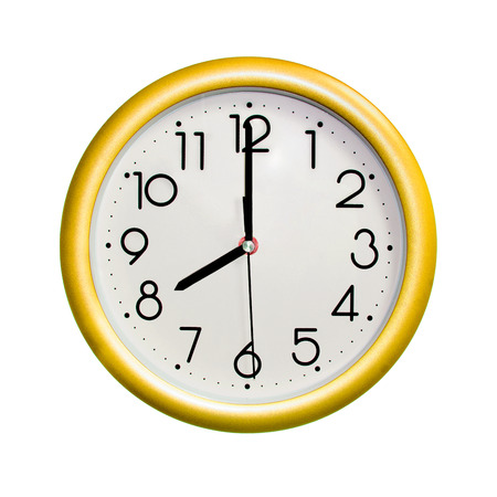 eight oclock, photo circle yellow wall clock, on white background, isolated Stock Photo