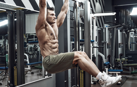 guy bodybuilder , perform exercise do chin-ups, horizontal bar in gym
