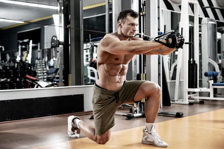 guy bodybuilder, perform exercise with exercise machine on pectoral muscles, in gym Stock Photo