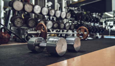 sports equipment in gym ,  dumbbells, horizontal photo Stock Photo