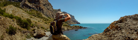 hiker on beauty landscape Crimea background, holiday traveling concept, horizontal photo Stock Photo