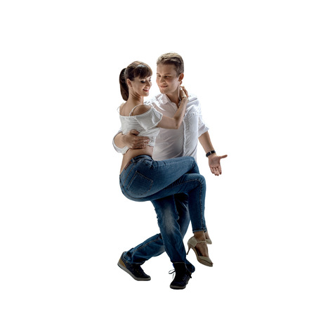 beauty couple dancing social danse (kizomba or bachata or semba or taraxia) , on white background, isolated