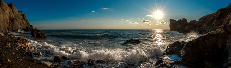 Beauty nature sea landscape Crimea, horizontal photo, panoramic view. The waves washed upon the rocks.