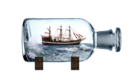 marine sailing vessel in glass bottle, photo on white background, isolated