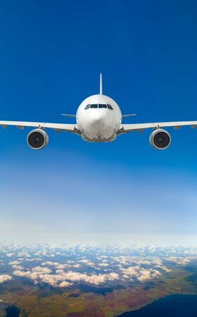 white, passenger airliner fly in sky, take-off of the plane with aircraft's undercarriage, landing gear extension Imagens