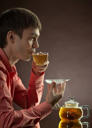 closeup portrait the beautiful man hold cup with green tea