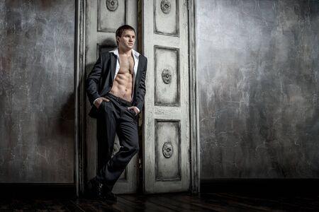 portrait muscular handsome sexy guy indoor