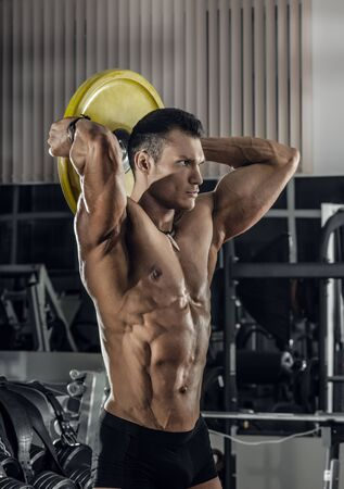 guy bodybuilder, perform exercise with barbell, in gym