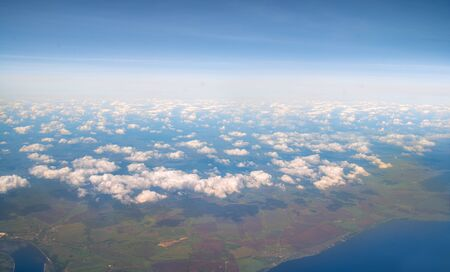 earth view from aircraft flight altitude and sky with clouds