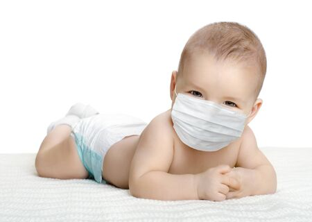 little baby in medical mask, on white background, isolated. Concept covid-19 coronavirus pandemic Archivio Fotografico