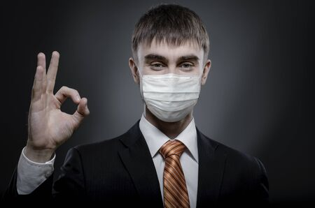 concept coronavirus epidemic, portrait businessman in medical mask to give hand gesture o.k.
