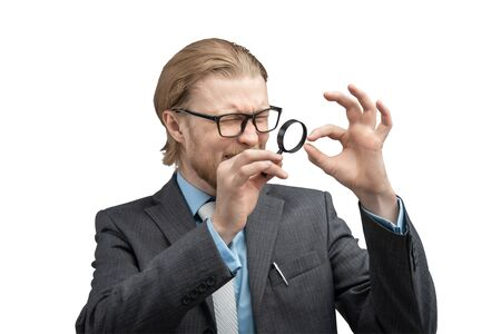 Portrait one man businessman or jeweler with magnifying glass in hand to consider peering, on white background, isolated. Stare, gaze concept
