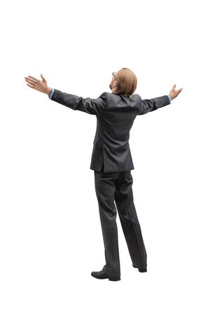 One fun businessman or office worker exults turn back, on white background, isolated. Triumphing and winner concept.