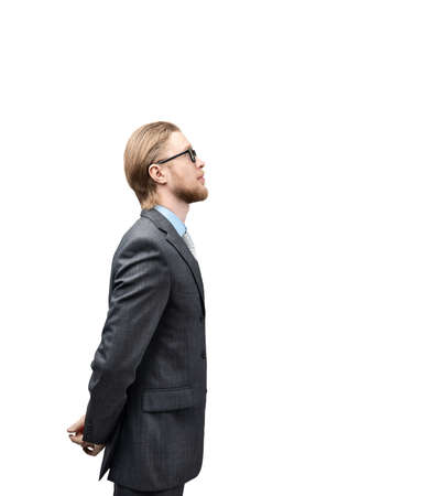vertical portrait one man businessman or office-worker in glasses spectacles, stand side view, on white background, isolated